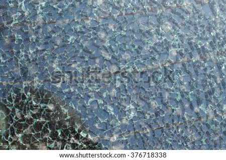 Close up photo of a broken windshield - stock photo