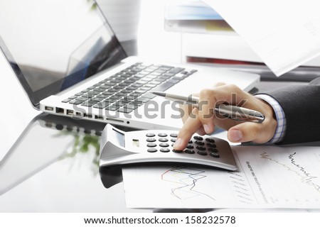 Close-up photo of a businessman analyzing financial data - stock photo