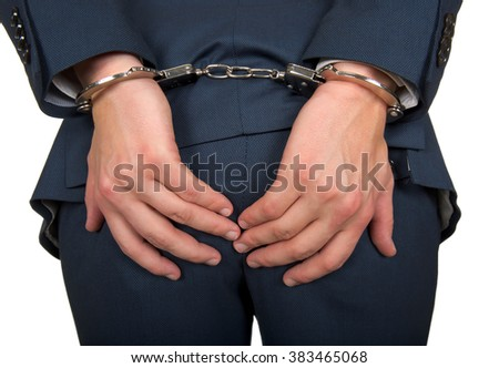Close up photo of a handcuffed businessman hands - stock photo