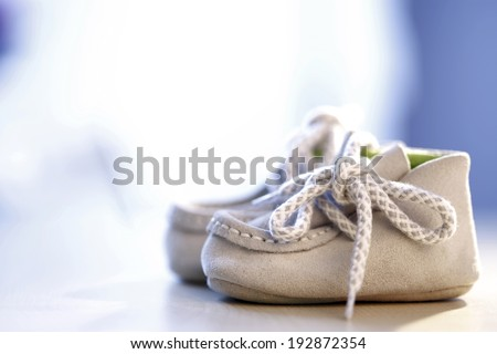 Close up photo of a pail of small slippers for toddlers - stock photo