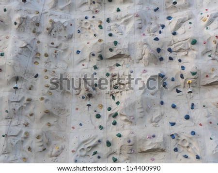Close up photo of a rock climbing wall - stock photo