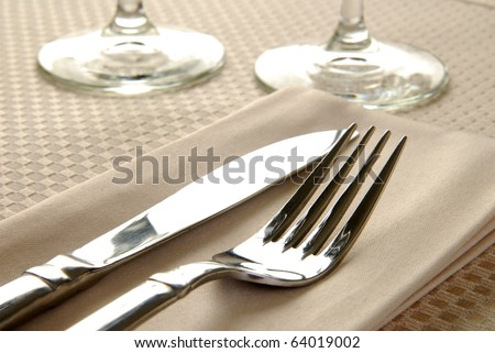 Close up photo of an elegant dinner table setting - stock photo