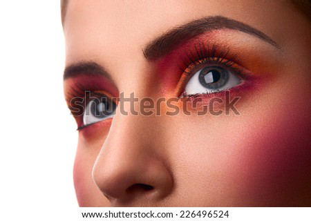 Close-up photo of beauty pink and orange makeup - stock photo