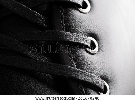 Close-up photo of black shoelaces on boot - stock photo