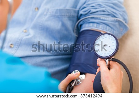 Close up photo of blood pressure measurement - stock photo