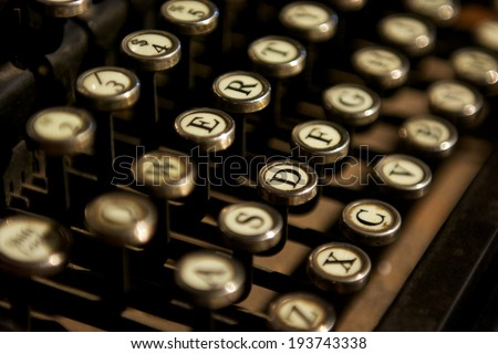 Close up photo of bronze vintage typewriter keys - stock photo