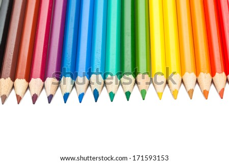 Close up photo of colour pencils isolated on white background
