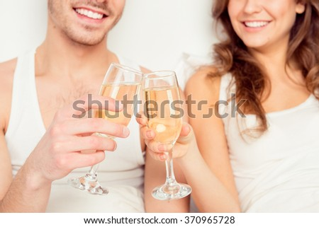 Close up photo of couple in love with glasses of champagne - stock photo