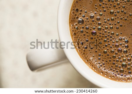 close up photo of dry foam on coffee, macro top view  - stock photo