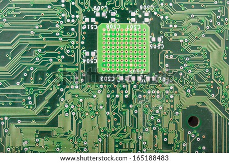 Close-up photo of electronic circuit board with integrated microchips