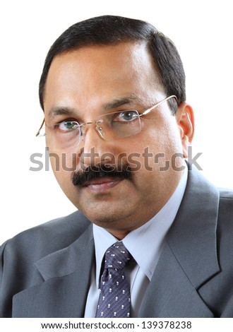 Close-up photo of face of an handsome Indian man having cautious and suspicious look. - stock photo