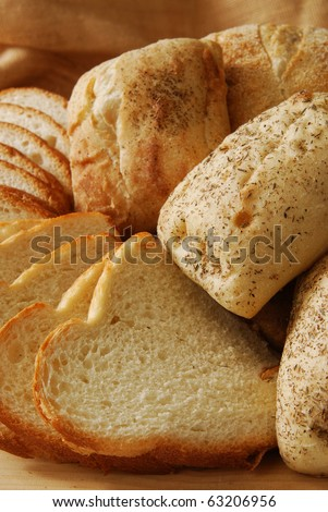 Close up photo of fresh artisan breads on a cutting board - stock photo