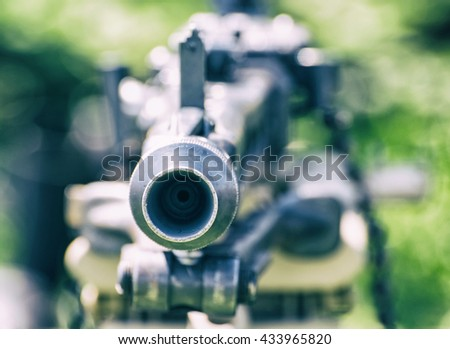 Close up photo of german historical machine gun of World War II. Cold photo filter. Ready to fire. War theme. Portable weapon. Blue toned. - stock photo