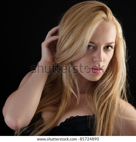 close up photo of girl with beautiful lips over dark background. - stock photo
