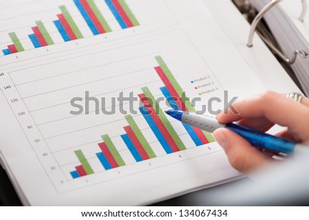 Close-up Photo Of Hand And Financial Graph - stock photo