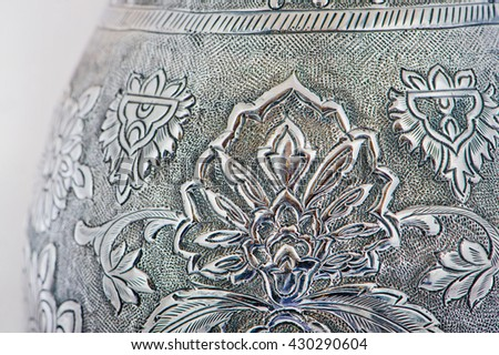 Close up photo of handmade silverware that is delicately handcrafted, silver handicrafts, Custom made authentic designs are the key factor in getting the fine art made. Decorative silver vase - stock photo