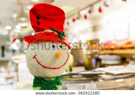Close up photo of happy snowman decor - stock photo