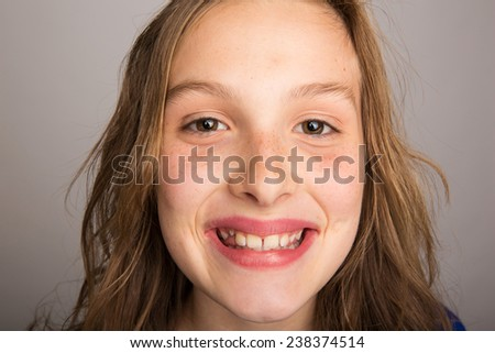 close up photo of happy young girl - stock photo