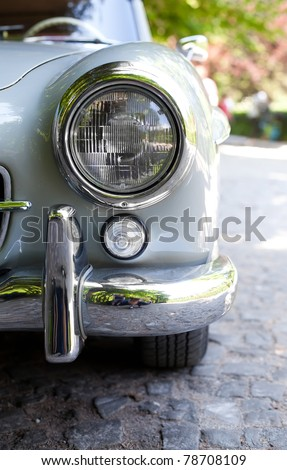 Close up photo of headlight retro car - stock photo