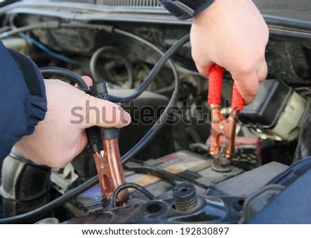 Close up photo of how mechanic charges the battery car
