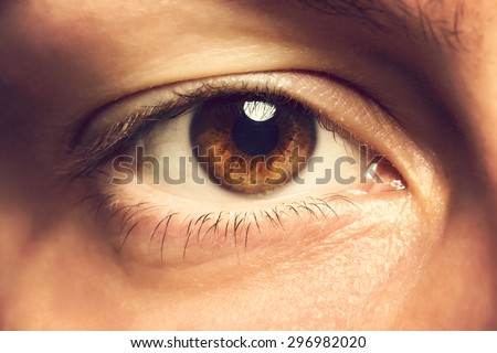 Close up photo of human eye. Toned photo