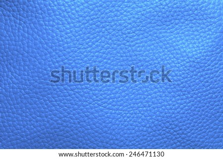 Close up photo of light blue color filtered leather surface texture style represent the surface background. - stock photo