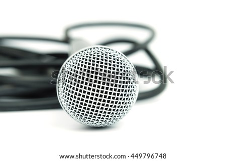 Close up photo of microphone and cable on white background - stock photo