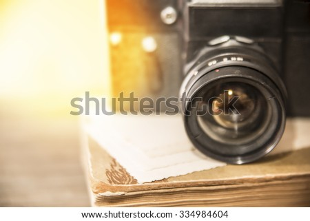 close up photo of old retro vintage aged camera lens over wooden table. image with selective focus Empty copy space for inscription or other objects  - stock photo