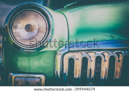 Close-up photo of retro car headlights - stock photo