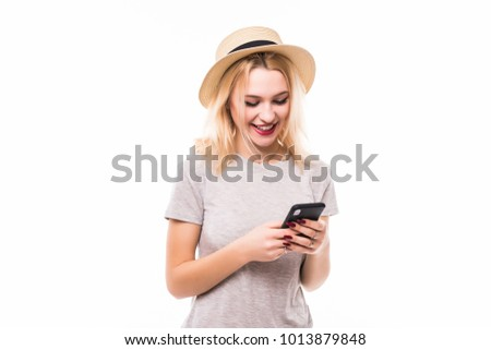 Close-up photo of serious young woman in straw hat, looking at phone