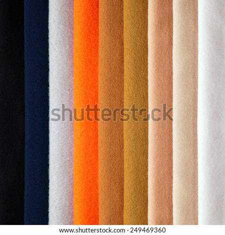 close-up photo of several colors of fabrics - stock photo