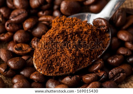 Close up photo of spoon with ground coffee in studio - stock photo