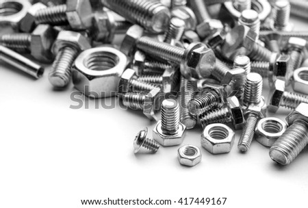 close up photo of steel bolts forming a texture
