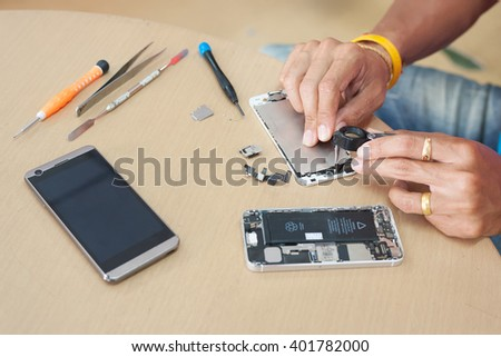 Close-up Photo Of Technician Hand Repairing Cellphone