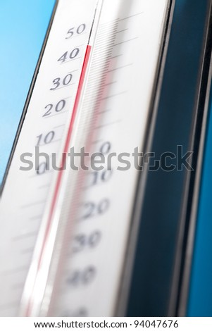 close up photo of thermometer on blue background