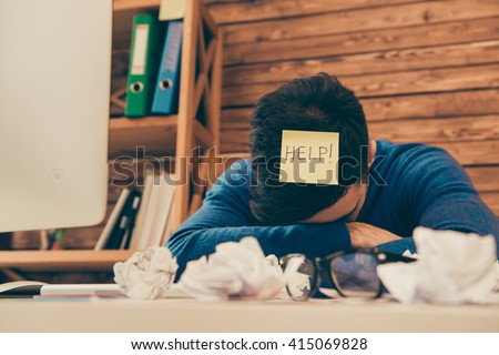 Close up photo of tired man having long working day and needing help - stock photo