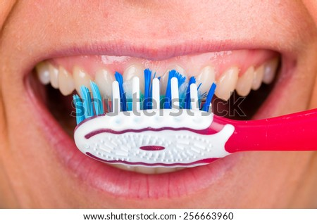 Close up photo of tooth cleaning with toothbrush - stock photo