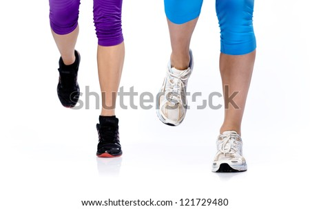 Close-up photo of two woman's legs running on a white background - stock photo