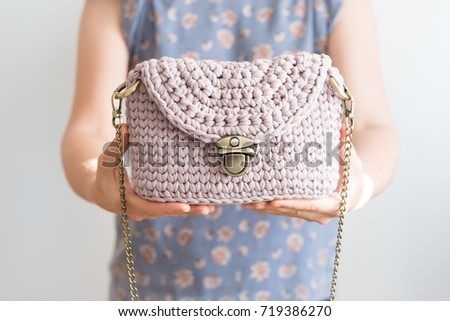 Close up photo of woman bag in hands of fashionable woman