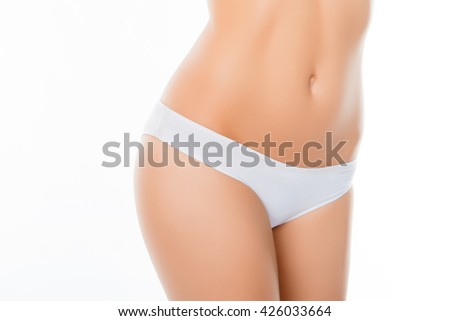 Close up photo of woman's belly and white panties