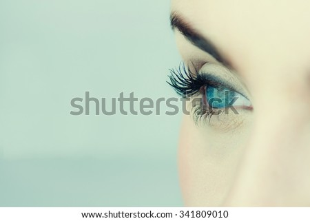 Close up photo of woman's blue eye. - stock photo
