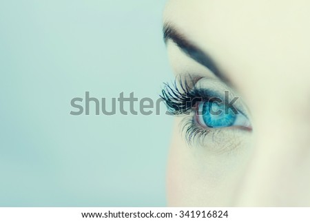 Close up photo of woman's blue eye.