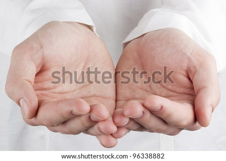 Close-up photograph of a human's open hands. - stock photo