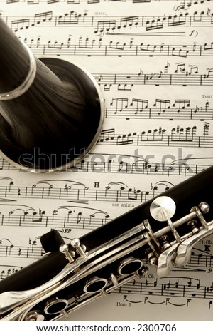 close up photograph of clarinet and sheet music - stock photo