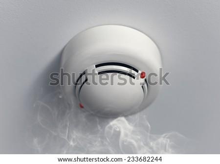 Close-up photograph of working smoke alarm - stock photo
