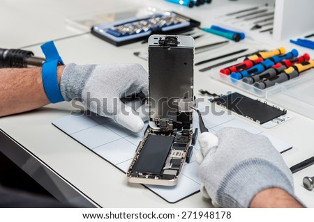 Close-up photos showing process of mobile phone repair - stock photo