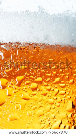 Close-up picture of a condensation on the glass of beer. - stock photo