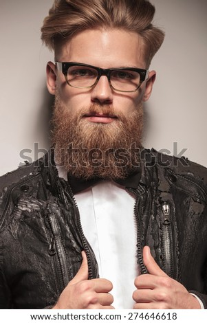 Close up picture of a handsome young business men pulling his collar. - stock photo