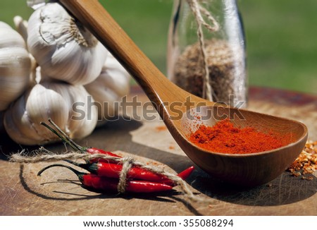 close up picture of a lot of red hot chilli peppers and spicy, garlic on wooden kitchen, curry - stock photo