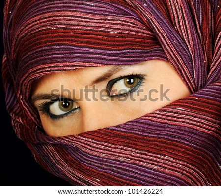 Close up picture of a Muslim woman eyes, wearing a  veil - stock photo